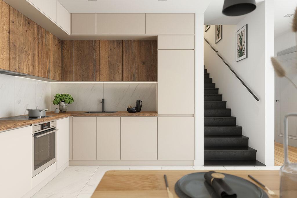 jasna kremowa zabudowa kuchni z drewnianym detalem